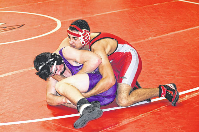 London's Cameron Burns, right, gets the best of Torin Foster of Bellbrook during the OHSAA Team Tournament Wednesday at London High School.