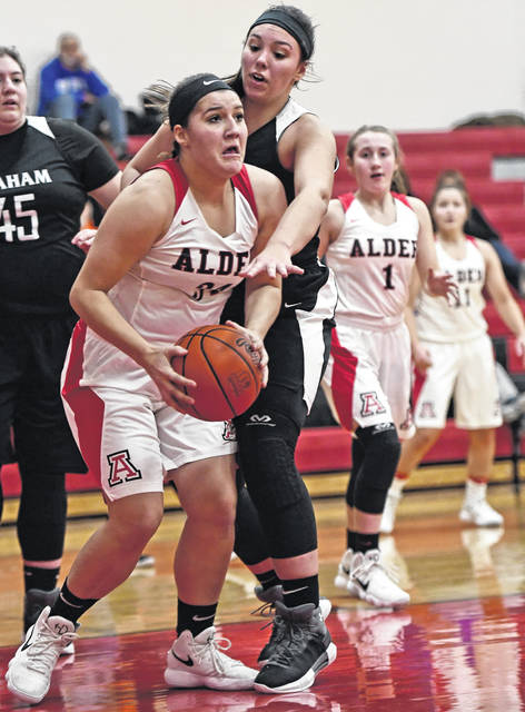 Jonathan Alder's McKenna Huff grabs control of the ball during the Lady Pioneers win over visiting St. Paris Graham Saturday.