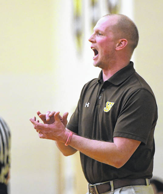 West Jefferson boys basketball coach Sam Seggerson barks out instructions during a game earlier this season.