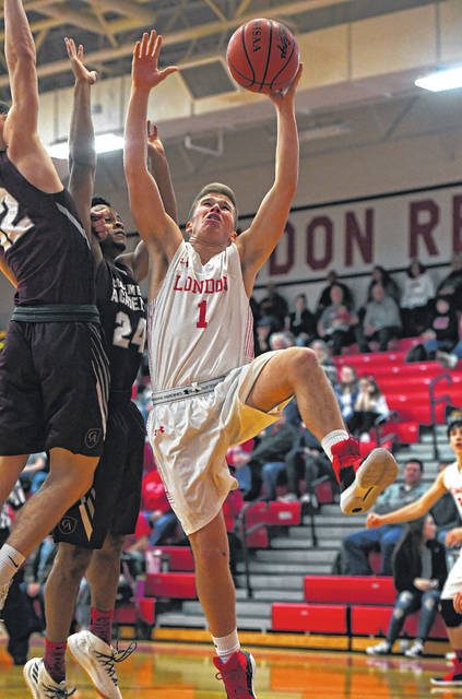 London's Josh Handley goes up for a shot during the Red Raiders loss to visiting Columbus Academy Saturday.