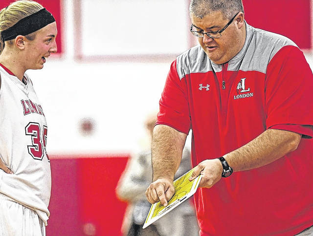London girls basketball coach Kevin Long gives Red Raiders center Hannah Coleman instruction during a win over Grandview last week.