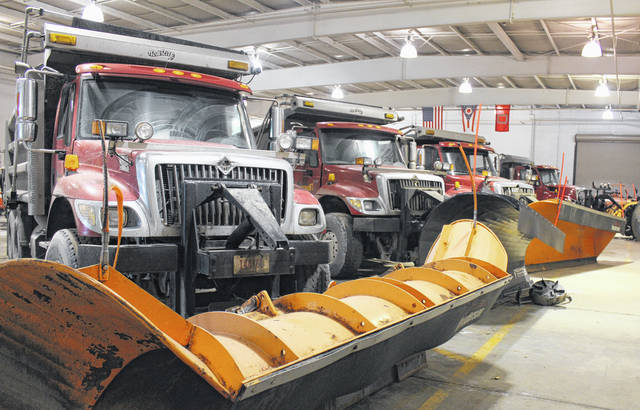 Trucks line the garage of the Madison County Engineer's office Wednesday ahead of the weekend's potential for winter weather. The county has eight plow trucks and three back-ups ready to combat conditions.