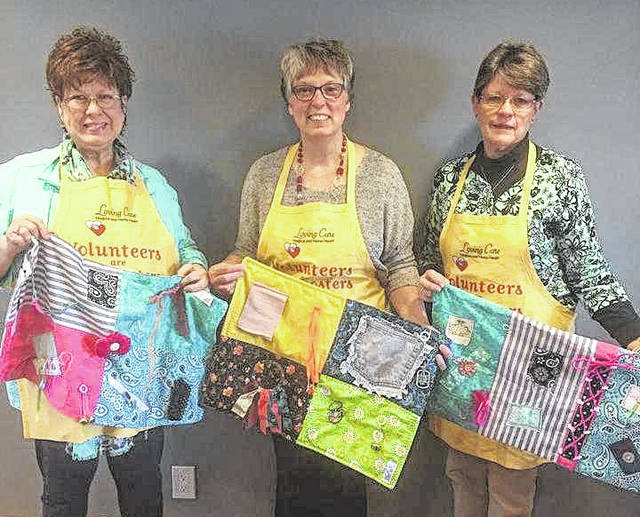 """Volunteers at Loving Care Hospice and Home Health hold """"fidget blankets."""" The blankets are designed to help patients with anxiety, Alzheimer's and Dementia. From left are: Judi Wolfe, Dee Greene and Jeanette McConnell."""