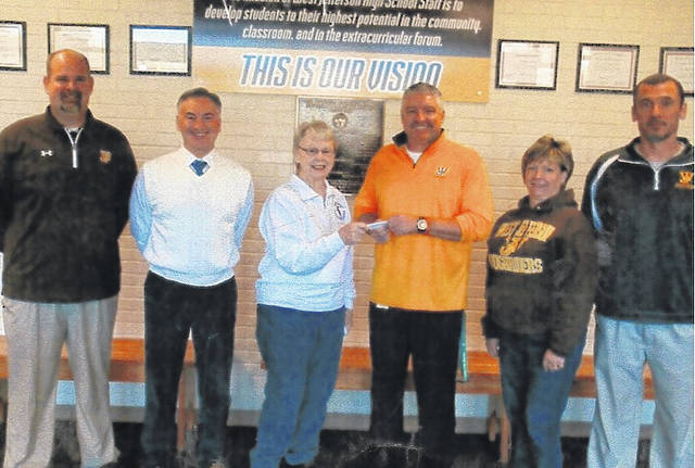 West Jefferson school administrators prepare to purchase their tickets to the West Jefferson Athletics Boosters Annual Spaghetti Dinner Fundraiser. They are from left: Matt Adams, Director of Athletics; William Mullett, Superintendent; Liz Harper, project coordinator; Mike Bute, High School Principal; Debi Omen, Middle School Principal; and Shawn Buescher, Middle School/High School Dean of Students and Head Football Coach.