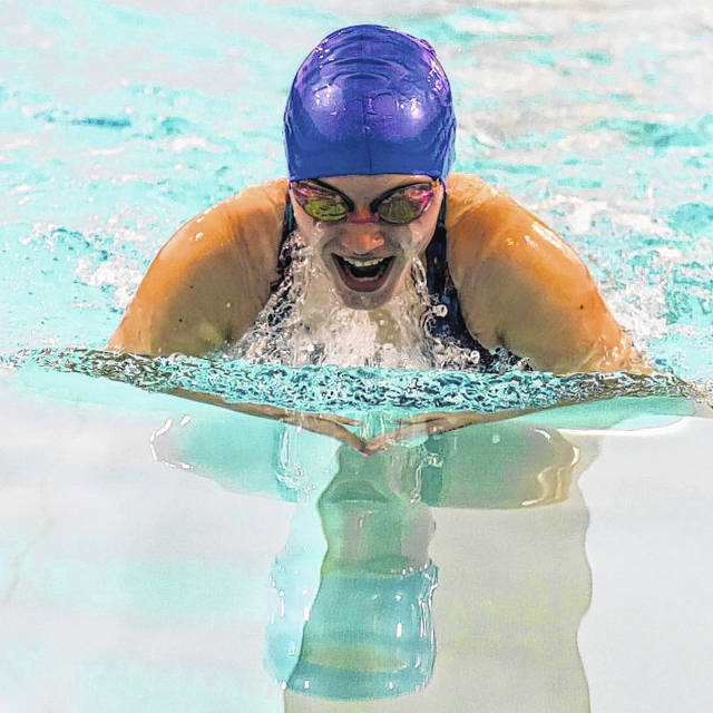 London sophomore Emily Bennett competes in the breaststroke during a recent meet. Senior Ethan Pozy are members of the inaugural season of London High School's Swim Team. They have been participating in meets throughout the winter months.