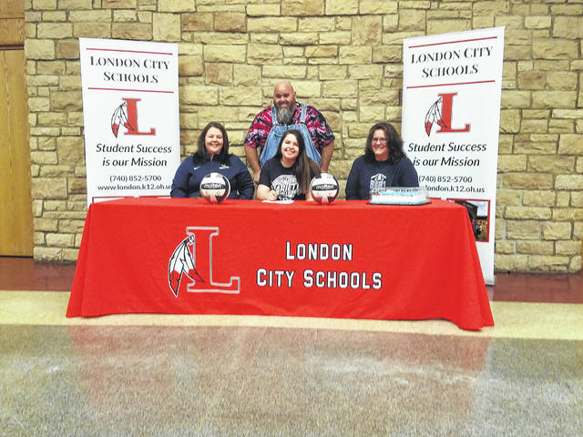 London High School senior Taylea Achtermann signed a commitment letter Thursday, Feb. 1, to play college volleyball for Marietta College. Joining her in a signing ceremony at the high school were sitting: Angie Hamilton (mother), Taylea Achtermann and Dee Lippke; standing: Rick Achtermann (father).