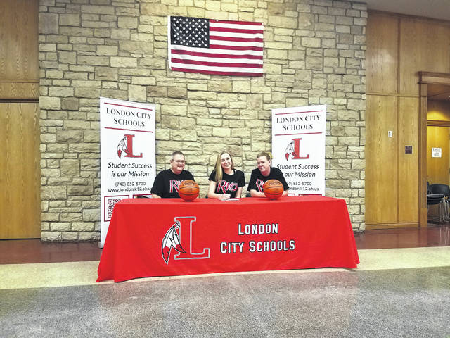 London High School senior Hannah Coleman recently signed a letter of intent to play basketball at the University of Rio Grande. She was joined in a ceremony at the high school by from left: Paul Coleman (father), Hannah Coleman and Stacy Coleman (mother). Coleman helped lead the Lady Raiders to an 18-3 record and the No. 1 seed in the Division II Central District tournament.