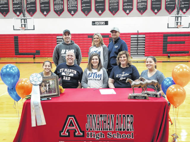 Jonathan Alder senior Brooke Bradley recently signed a National Letter of Intent to join the Equestrian team at the University of Tennessee at Martin. Front row from left are: The Bradley Family of Brenna, Dan, Brooke, Melissa and Blaire; second row: Trainers Andrew Seaman (AK Show Horses), Katie and Chad Piper (Piper Performance Horses).