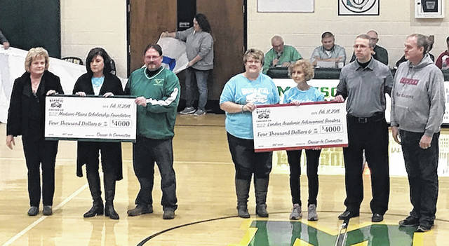 Members of the Martha Geib Cruise-In Committee present Madison-Plains and London City Schools with checks totaling $4,000 each at the basketball game between the two schools held at the Madison-Plains High School gym Saturday, Feb. 16. The money is raised for student scholarships in honor of the late Dr. Martha Geib, who was serving as a board of education member for London City Schools when she passed. From left are: committee members Marci Bogenrife and Christina Finney; Madison-Plains High School Principal, Dr. Matt Unger; committee members Kelly Snyder and Connie Dwyer; London High School Principal Chad Eisler; and Marshall Geib, husband of Martha Geib, representing London High School Academic Achievement Boosters and the Geib family.