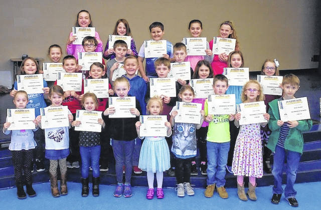 """February Roughriders of the Month for Norwood Elementary School in West Jefferson are front row from left: kindergarten, Megan Landis, Harleigh Bendure, Kynlie Stevers, Kylie Childers-Litchfield and Zurie Clark, first grade, Morgan Bates, Carson Jones, Alyia Nichols and Drake Megahey; second row: second grade, Madison Nicewander, Landen Koehler, Chayce Campbell and Colten Thomas, third grade, George Thompson, Reese Fry, Avery Friessen and Clair Pressnell; third row: fourth grade, Holly Markley, Phillip Kocher, Braden Collins and Evan Reynard; fourth row: fifth grade, Kimberly Stout, Kennedy Taylor, Hunter Miller, Kimberly Warnock and Zoey Brown. Students exhibiting the Rider Virtue of """"Responsible"""" earned a certificate, two spirit sticks, and ate lunch with their principal, Susan Barte."""