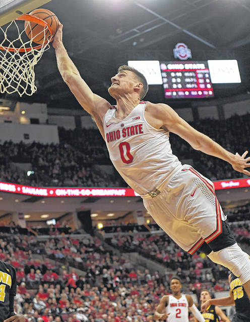 Ohio State's Micah Potter soars to the basket during the Buckeyes win over Iowa Saturday.