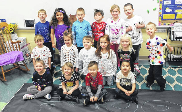 London Elementary School kindergartners celebrated their 100th day of school by presenting a fashion show on Tuesday. Each member of Kristen Crane's class designed a T-shirt with 100 items. Front row from left are: Lexie Jordan, 5, Rylei Meadows, 5, Jackson Stevens, 6, and Herman Paniagua, 6; second row: Colten McClain, 5, Carlie Barcus, 5, Logan Hart, 6, McKenzie Brooks, 6, and Libby Beightler, 6; third row: Aiden Bock, 6, Kiandra Oiler, 5, Clark Ewing, 6, M.J. Boyd, 5, Adelyn Rupejko, 6, Zander Thomas, 6, and Nathan Rickman, 7.