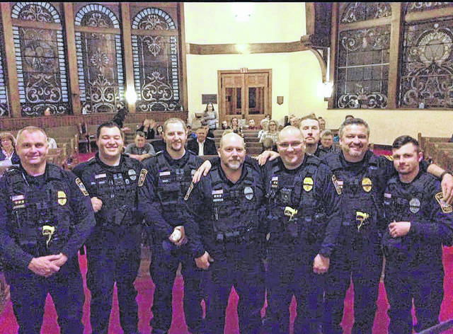 Members of the Plain City Police Department took part in a community prayer at Plain City's Presbyterian Church Thursday. The service was held to bless the PCPD and recognize the two fallen officers in the Westerville shooting on Feb. 10. From left are: Lt. Tom Jaskiewicz, Ofc. Stephen Drake, Ofc. David Drudy, Det. Philip Greenbaum, Sgt. Tharon Prather, Ofc. Ryan Flowers, Chief Dale McKee and Ofc. Josh Hirtzinger.