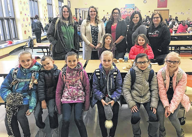 Students and their parents gathered at London Elementary School Friday morning for the Muffins with Moms breakfast.