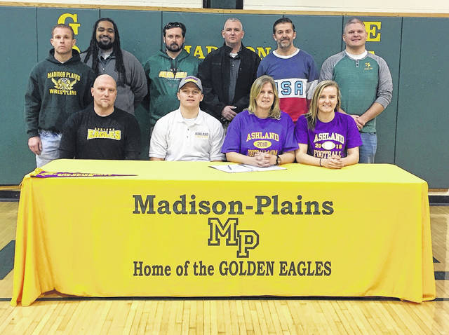 Madison-Plains senior Ryan Bevington recently signed a letter of intent to play football at Ashland University. He was joined by front row from left: Tom Bevington (father), Ryan Bevington, Nickie Bevington (mother) and Tori Bevington (sister); second row: Mike Siders, Drew Basil, Sam Coil, Dave Thompson, Coach Jason Hunt and Athletic Director Matt Mason.