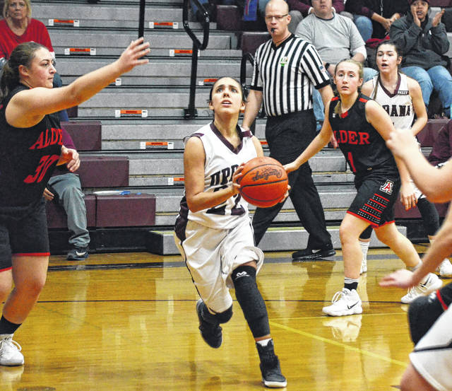 Urbana's Samantha Rooney (22) penetrates the Jonathan Alder defense on Wednesday. Urbana struggled with the Pioneers' press, turning the ball over frequently.