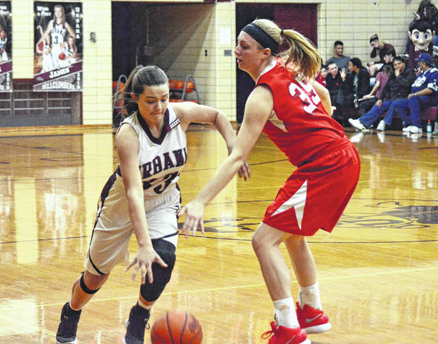 Urbana's Shelby Stoops (33) goes around London's Hannah Coleman on Monday. After a cold start, Stoops, a freshman, broke open the Hillclimbers' scoring with about 6:30 left in the second quarter.