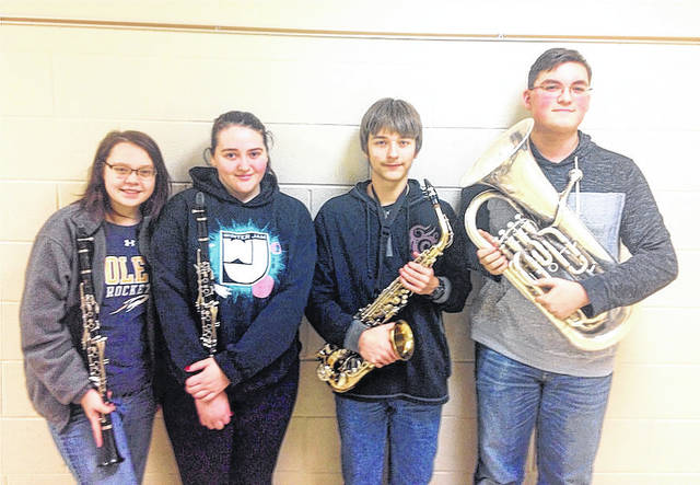 Recently, four West Jefferson High School Band students successfully participated in the Ohio Music Education Association Solo and Ensemble Competition. Performing as soloists were from left: sophomore Merrick Crawford (Clarinet, Class C), sophomore Celina Jeffers (Clarinet, Class B), freshman Wesley Miller (Saxophone, Class C), and freshman Alex Ruble (Euphonium, Class B). Ruble earned a Superior rating, while Crawford, Jeffers, and Miller each earned ratings of Excellent. The students are under the direction of Elmer Broecker.