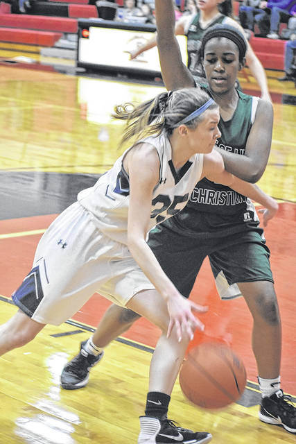 Shekinah Christian's Natalie Headings drives past a Tree of Life defender during the Flames tournament opener last week. The No. 3 seed however was unable to knock off No. 4 Danville Saturday and had its season come to an end.