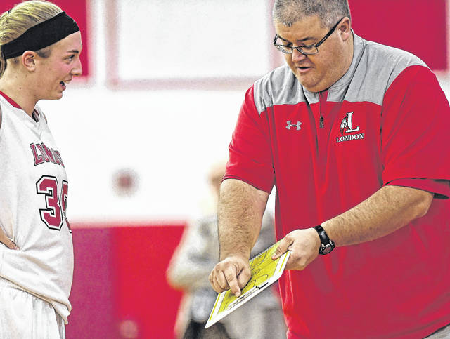 London High School girls basketball coach Kevin Long explains a few things to Red Raiders post player Hannah Coleman during a game earlier this season. London is the No. 1 seed in upcoming Division II Central District tournament.