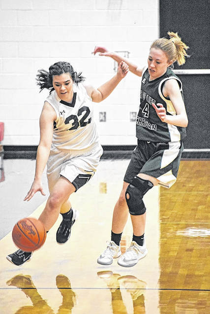 Shekinah Christian's Mandi Scheffel gets past a Tree of Life Christian defender during the Flames' district tournament win Wednesday at Jonathan Alder.