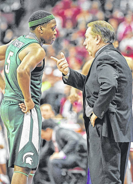 Michigan State basketball coach Tom Izzo gives Spartans guard Cassius Winston instruction during a game at Ohio State earlier this season.