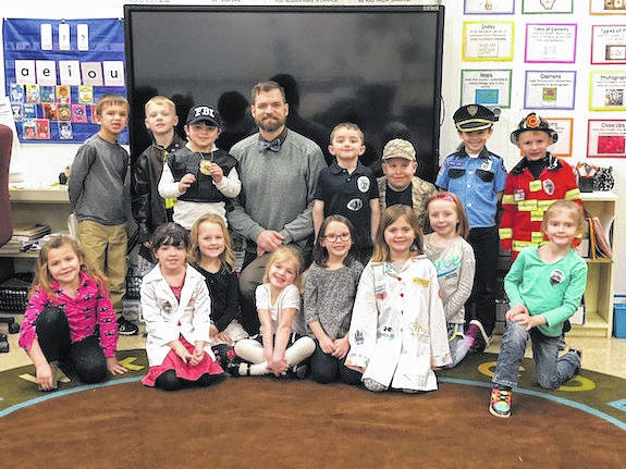 London Mayor Patrick Closser spent some time Friday, March 2, with the St. Patrick's School kindergarten class talking about how to be a community helper, his job and life lessons. All of the students in Elizabeth Kennell's class dressed up as their favorite community helper.