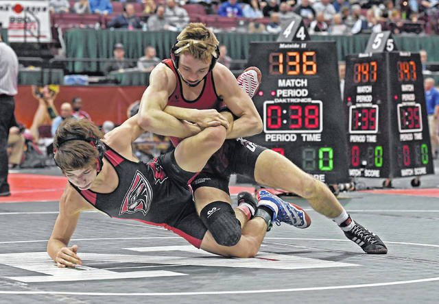 Jonathan Alder's Jacob Johnson, top, gets the best of his opponent Keegan Kohlert from Fairfield Union during the opening round of the OHSAA Division II state wrestling championships Thursday at Ohio State University.