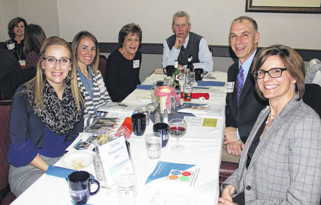 Members of Madison Health await dinner dismissal at the Chamber of Commerce awards dinner Thursday. The dinner is held every year at the London Country Club to celebrate the county's achievements.