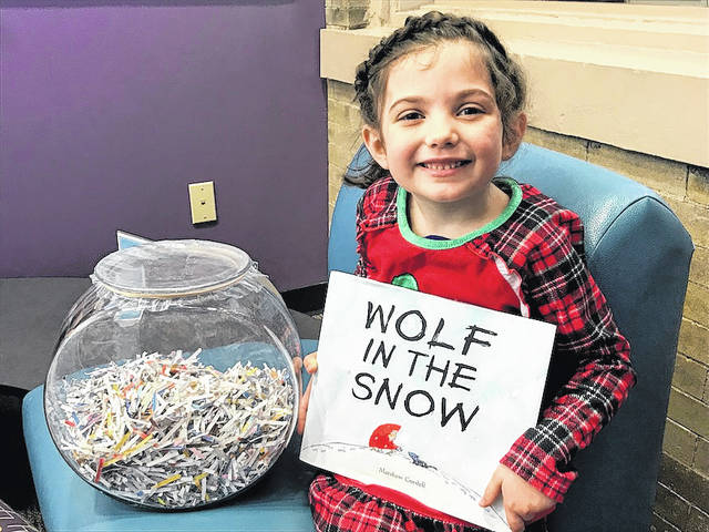 """Milly Byrd, 5, of London, correctly guessed London Public Library's shredded book contest. It was """"The Snowy Day"""" by Ezra Jack Keats. Her prize was this year's Caldecott medal winner """"Wolf in the Snow"""" by Matthew Cordell. The contest was held Saturday, Feb. 17 through Thursday, March 1."""
