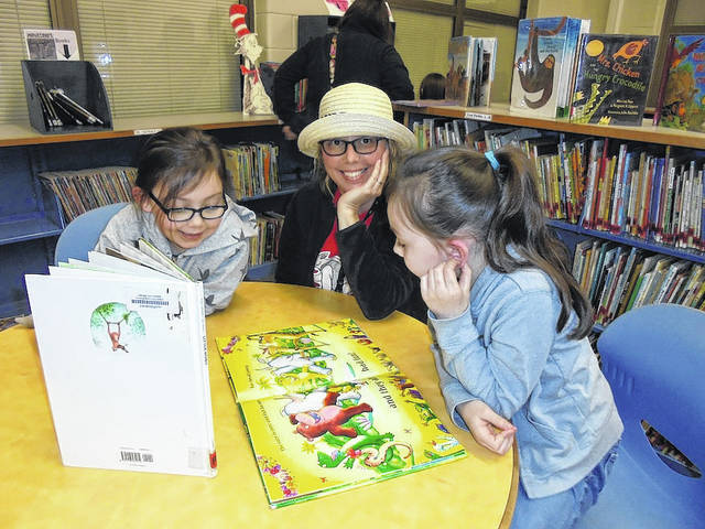 Norwood Elementary School in West Jefferson has been celebrating their Right to Read Week Right to Read Week Monday, Feb. 26 through Friday, March 2 with the theme of Wild About Reading. From left are: Aaliyah Lamnguen, Janette Harding, and NyAsia Lamnguen.