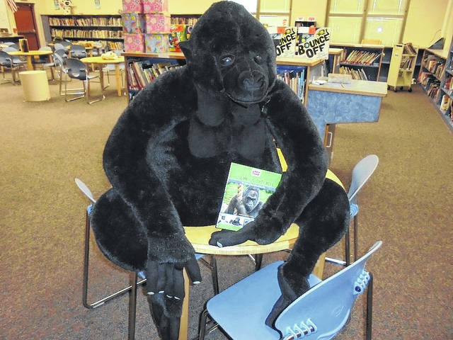 "Nancy Poe Pimm's big stuffed gorilla reading one of her books ""Colo's Story"" during Family Reading Night on Tuesday, Feb. 27 at Norwood Elementary School."