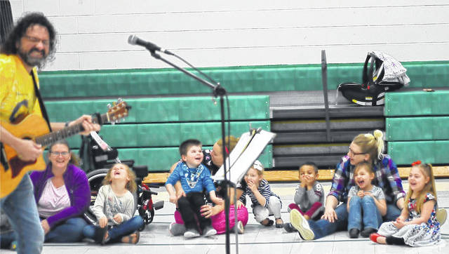 "Mark ""The Toy"" Rossio entertains the crowd during Thursday's Grandfriends Day at the Madison County Board of Developmental Disabilities' Fairhaven School. Rossio is a much-anticipated annual visitor who always keeps the audience laughing."