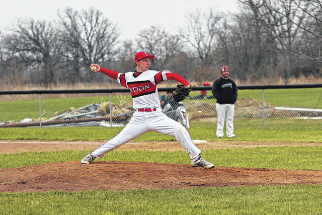 London junior Cameron Greenhill fires a pitch toward the plate during the Red Raiders win over Whitehall Tuesday, April 10.