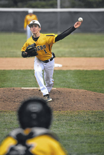 West Jefferson's Jake Boyd fires a pitch toward the plate during the Roughriders 6-0 win over Madison-Plains Tuesday.