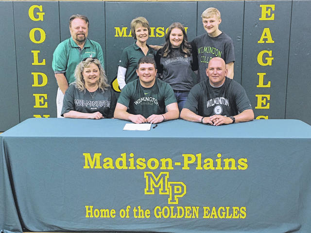 Madison-Plains High School senior Nick Thompson signed a commitment letter to play football at Wilmington College. He was joined by front from left: Rachel (mother), Nick, Dave (father); back: Terry (grandfather), Greta (grandmother), Abby (sister) and Ben (brother).