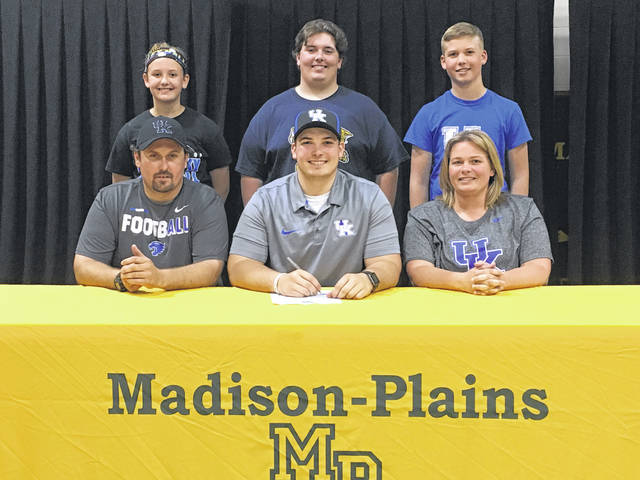 Madison-Plains Chris Coil recently signed to play football at the University of Kentucky. He was joined by front from left: Sam Coil (father), Chris Coil and Sarah Coil (mother); back: Kyla Coil (sister), Hunter Coil (brother) and Evan Coil (brother).