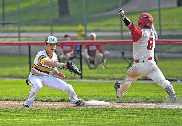 West Jeff's Jake Boyd hauls in a throw at first base during the Roughriders 8-1 district tournament loss Thursday.