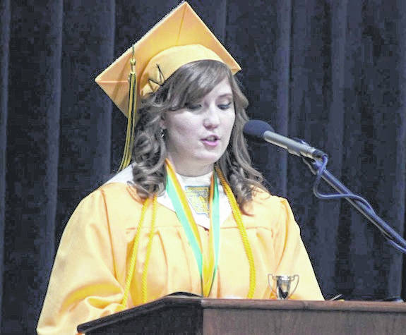 Jenna Lawless, co-valedictorian for Madison-Plains class of 2018, addresses the crowd Friday evening at the high school commencement. The gymnasium was packed with loved ones waiting to see their graduate cross the stage to receive a diploma.