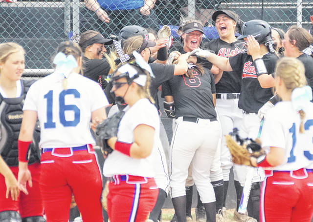Jonathan Alder teammates welcome Angela Brandel (6) at home plate following a second inning home run in the Pioneers regional final win over Clinton-Massie Saturday at Mason High School.