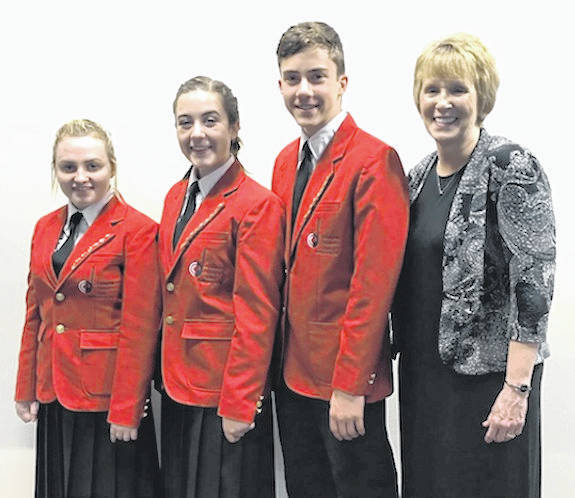 Local singers from left, Nicole Evans, Ruth Peart and Luke Peart will be living a musician's dream as they perform at Carnegie Hall next week as part of the New World Singers of the Columbus Children's Choir. With them is the choir's Artistic Director, Jeanne Wohlgamuth.