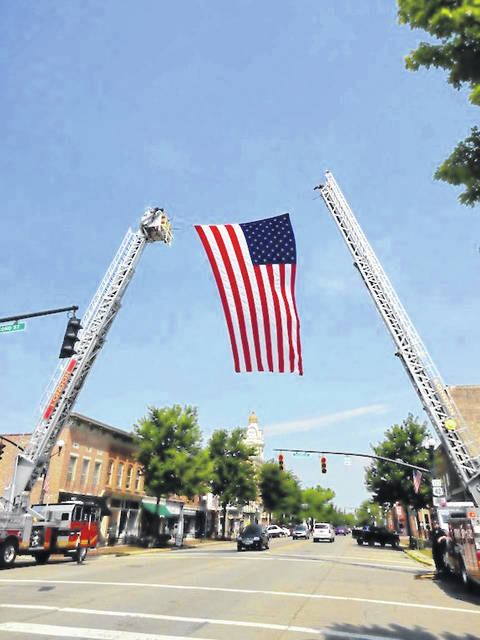 Fire ladders arched over Main Street Saturday for the funeral of former London mayor, David Eades.