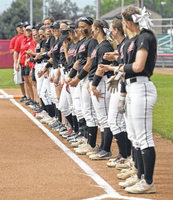 Members of the Jonathan Alder softball team lineup prior to the start of the state semifinal game Thursday in Akron.