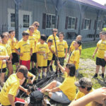 Campers plant sunflower seeds
