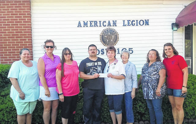 The American Legion Post No. 105 Ladies Auxiliary recently held a bourbon chicken fundraiser for Special Olympics. On hand for the check presentation were from left: Bevi Whitelow, Susan Thompson, Cheryl Homeier, Special Olympics athlete Nick Dummitt, Linda Stier, Jill Boggs, Caternia Pierce and Stefanie Cunningham.
